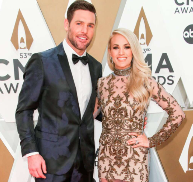Mike Fisher with his wife Carrie Underwood