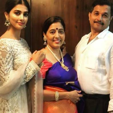 Pooja with her parents