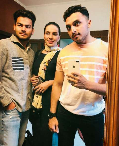 Amber Zaidi with her brothers