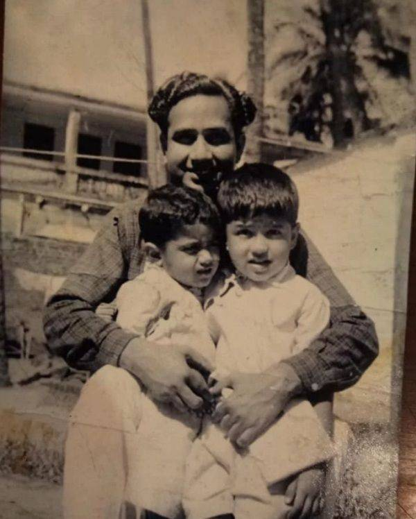 Abu Malik's childhood picture with his brother and his father