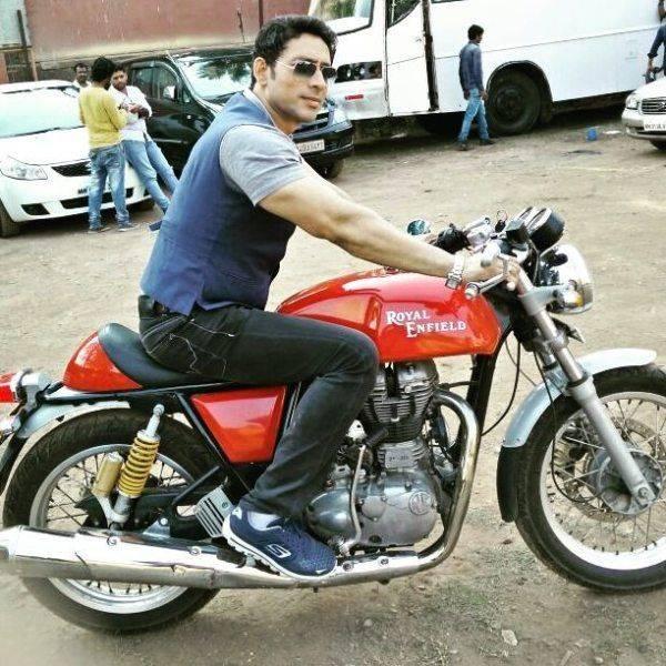 Hrishikesh Pandey posing on his motorcycle