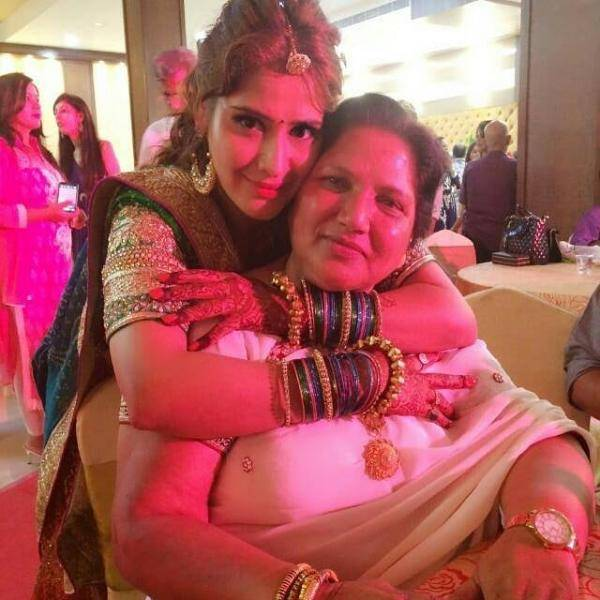 Arti Singh with his mother
