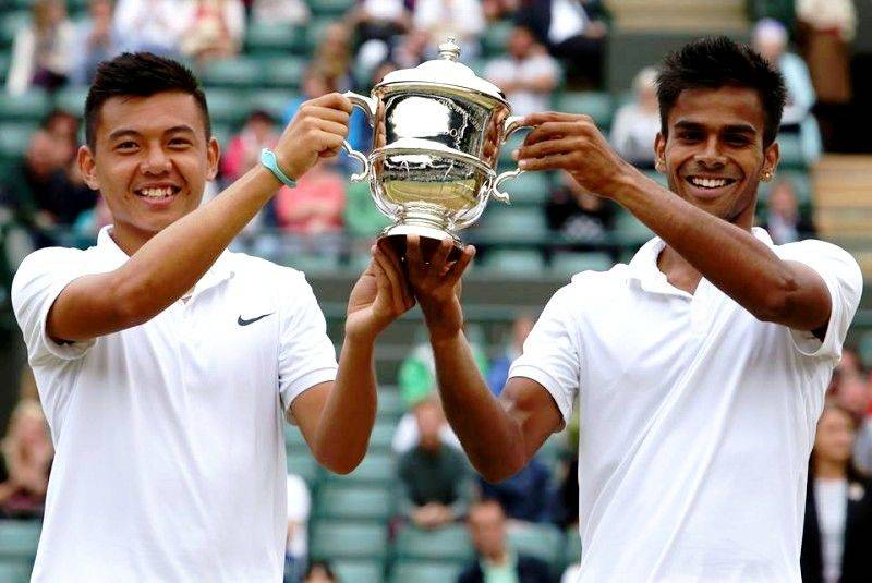 Sumit Nagal with Lý Hoàng Nam after winning the men's double at Wimbledon