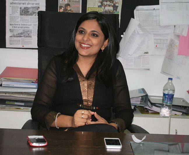 Richa Anirudh sitting in his office