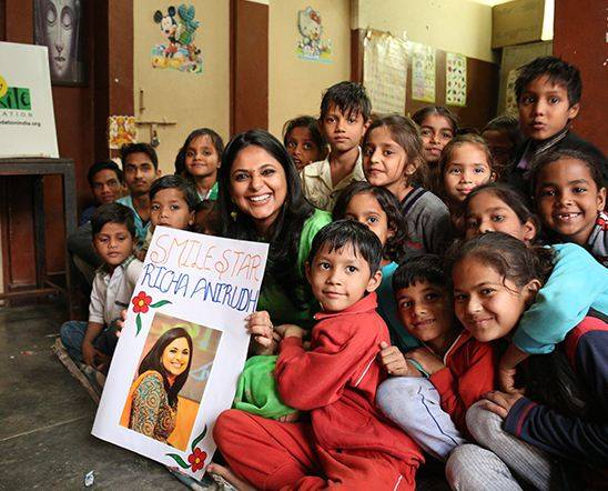 Richa Anirudh with poor children