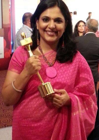 Richa Anirudh holding a prize