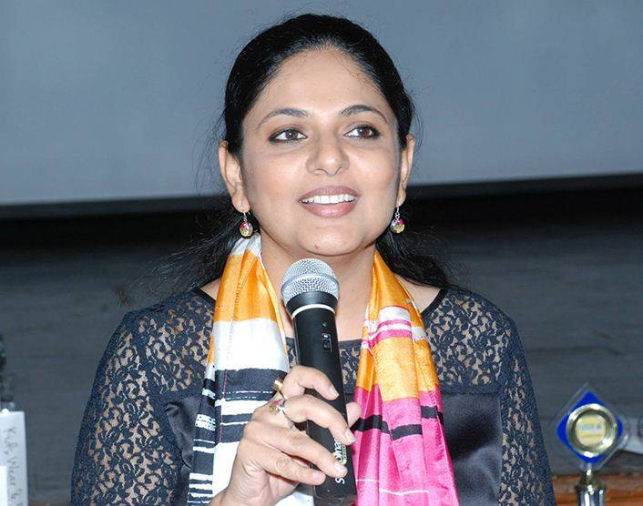 Richa Anirudh addressing students as an ambassador for the SQL brand