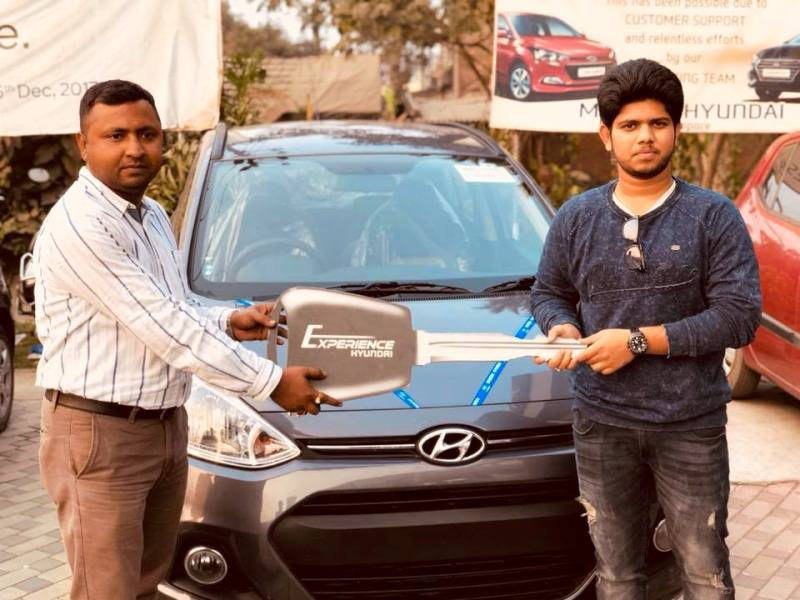 Adriz Ghosh posing with his car