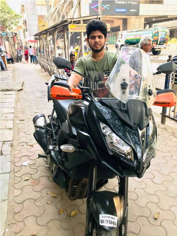 Adriz Ghosh posing with his motorcycle