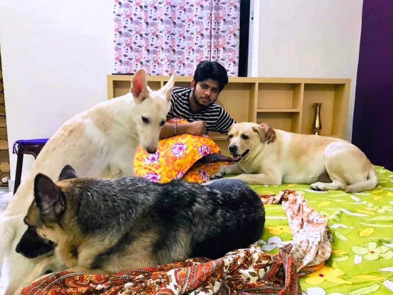 Adriz Ghosh with his dogs