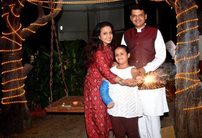 Devendra Fadnavis with his wife Amruta Fadnavis and his daughter Divija Fadnavis