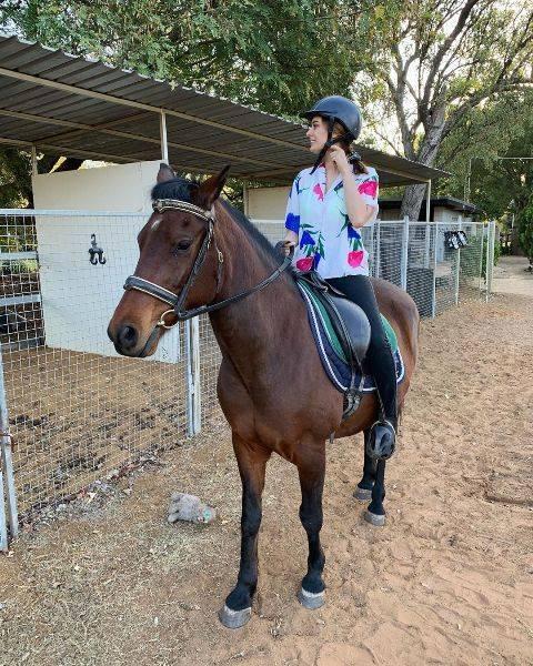 Evelyn Sharma on horseback