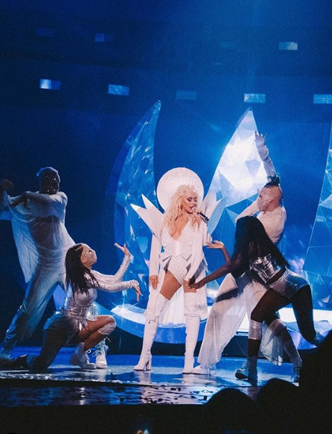"Christina Aguilera TheXperience ""data-caption ="" VerifiedWe call this outfit ""It has arrived""! 💎 Swipe to see how @garethpughstudio brought this beautiful vision to life! 🌌 #TheXperience ""data-source ="" https://www.instagram.com/p/ByqLQi2JcOY/"