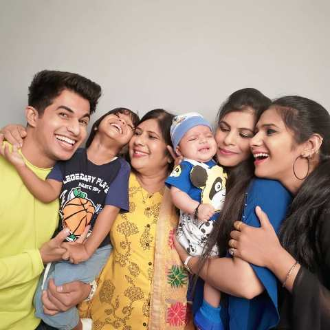 Aadil Khan with his mother and sisters