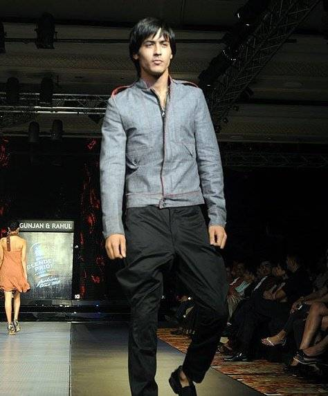 Abhimanyu Tomar walking on the ramp for fashion designers Gunjan and Rahul