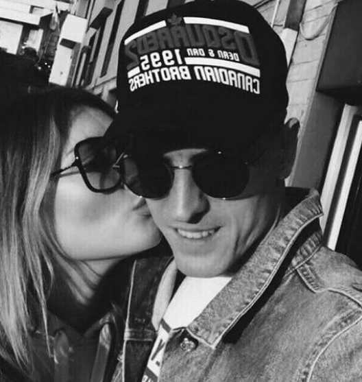 Piatek with his girlfriend