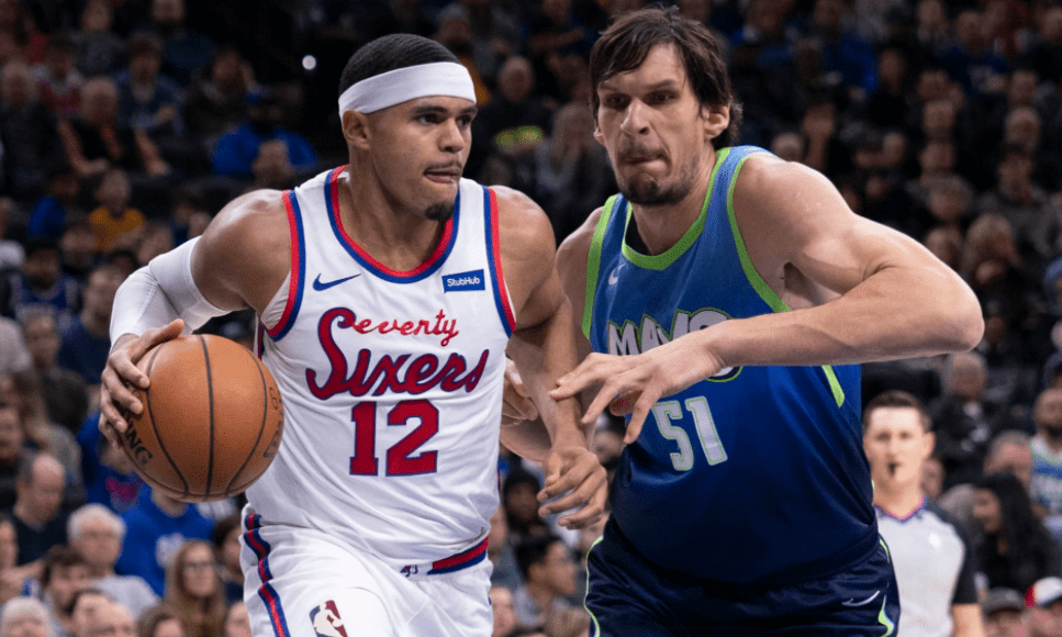 Tobias Harris (left) heads the ball against the opponent