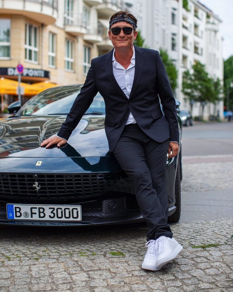 Oliver from Sochi with black Ferrari next to him.
